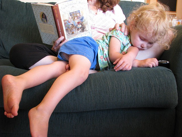 August, 2008. Heart in my throat, looking at this photo today—now I'm reading that same book to this wee girl!