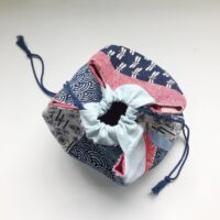 Top view of a handmade drawstring bag in red and blue fabrics