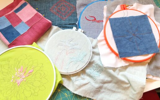 An assortment of embroidery projects in progress